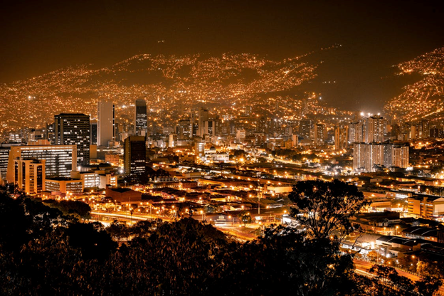 An aerial view of Medellin, Colombia, at night depicting opportunities for foreign buyers