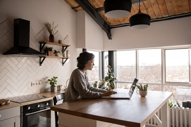 A woman researching short-term and long-term rental homes