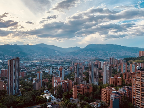 City of Medellin with tall buildings and hilly background